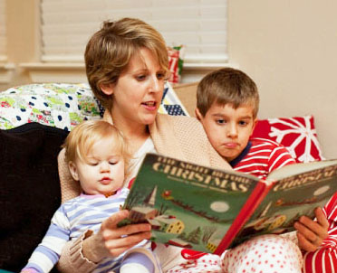 Reading favorite Christmas book with kids