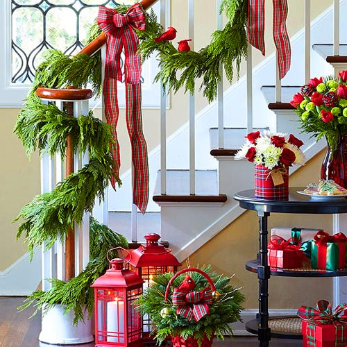 Decorating Staircase Railing By Hanging Garland
