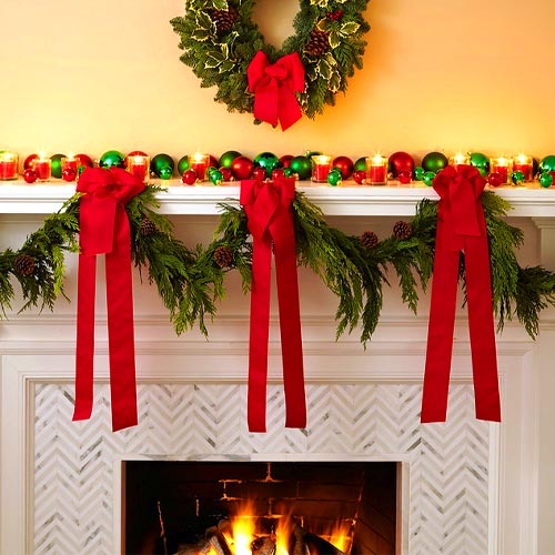 Hanging Garland Decorations On Fireplace Mantel